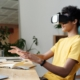 Young man using VR headset